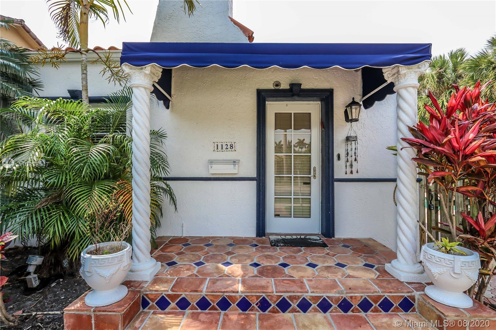 This rare 1939 Spanish Style Estado home located in one of Hollywood's Lakes Landmark Streets loaded