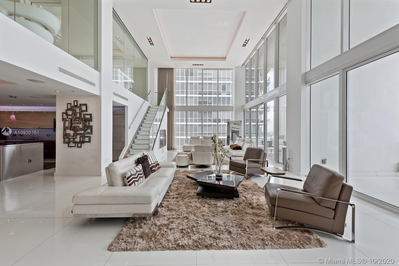 Exquisite tri-level, custom built, lower penthouse that boasts the finest details through-out, with