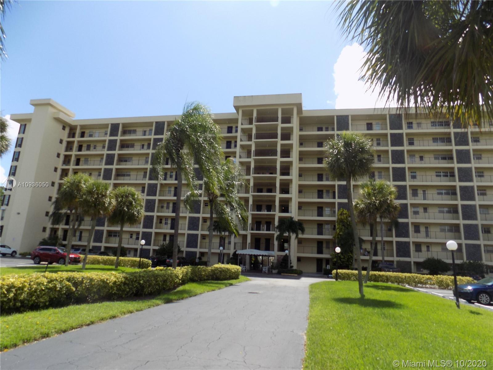 Great remodeled corner unit apartment in palm Aire Country Club with panoramic golf view. Remodeled