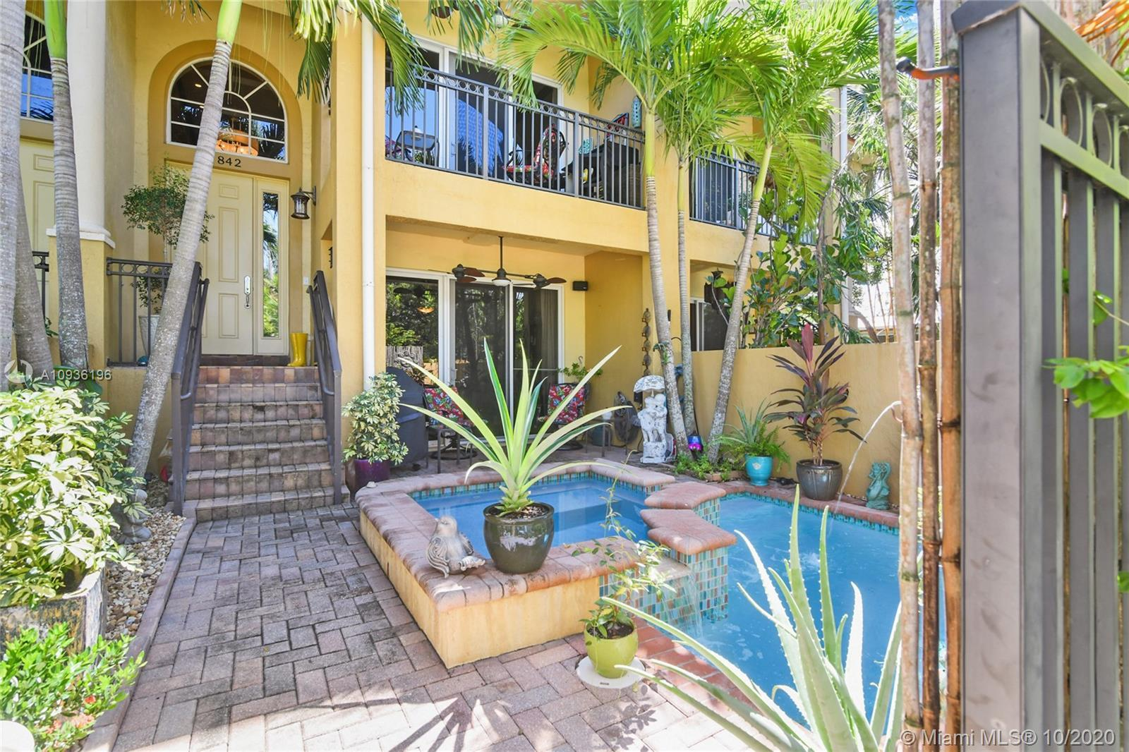 Exquisite Tri-Level Townhome in the heart of Wilton Manors.  This home has been upgraded with magazi