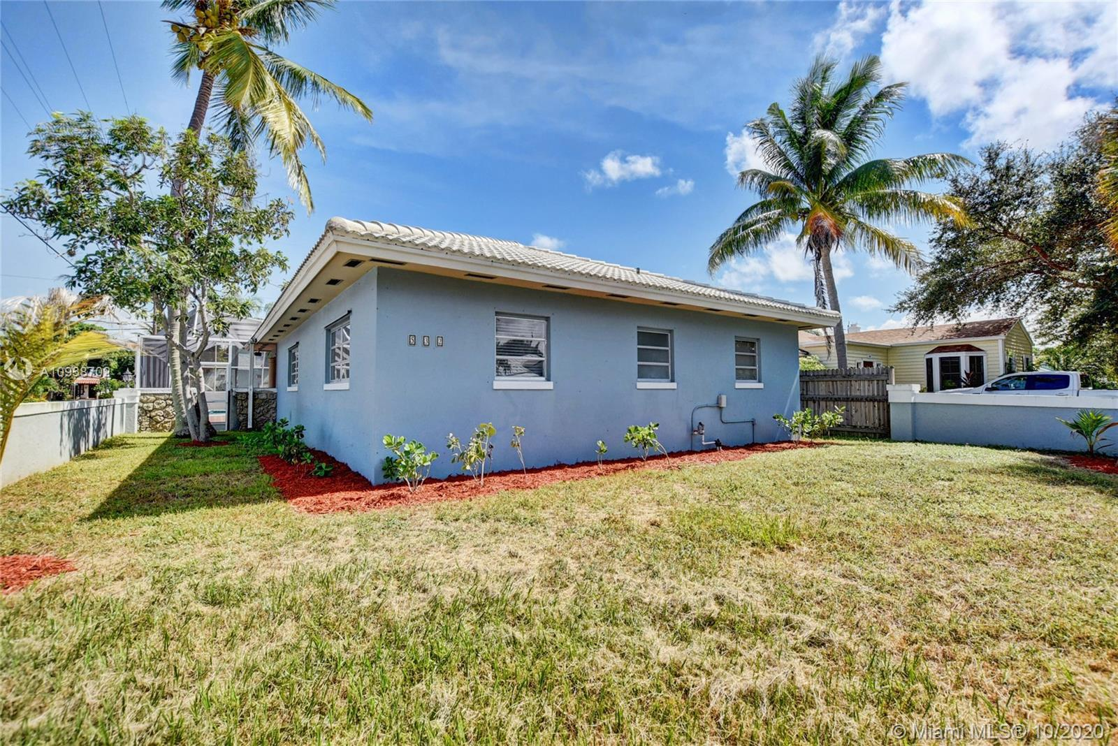 Fantastic 3 bedroom, 2 bathroom single family corner lot home with a pool home in Lake Worth! This h