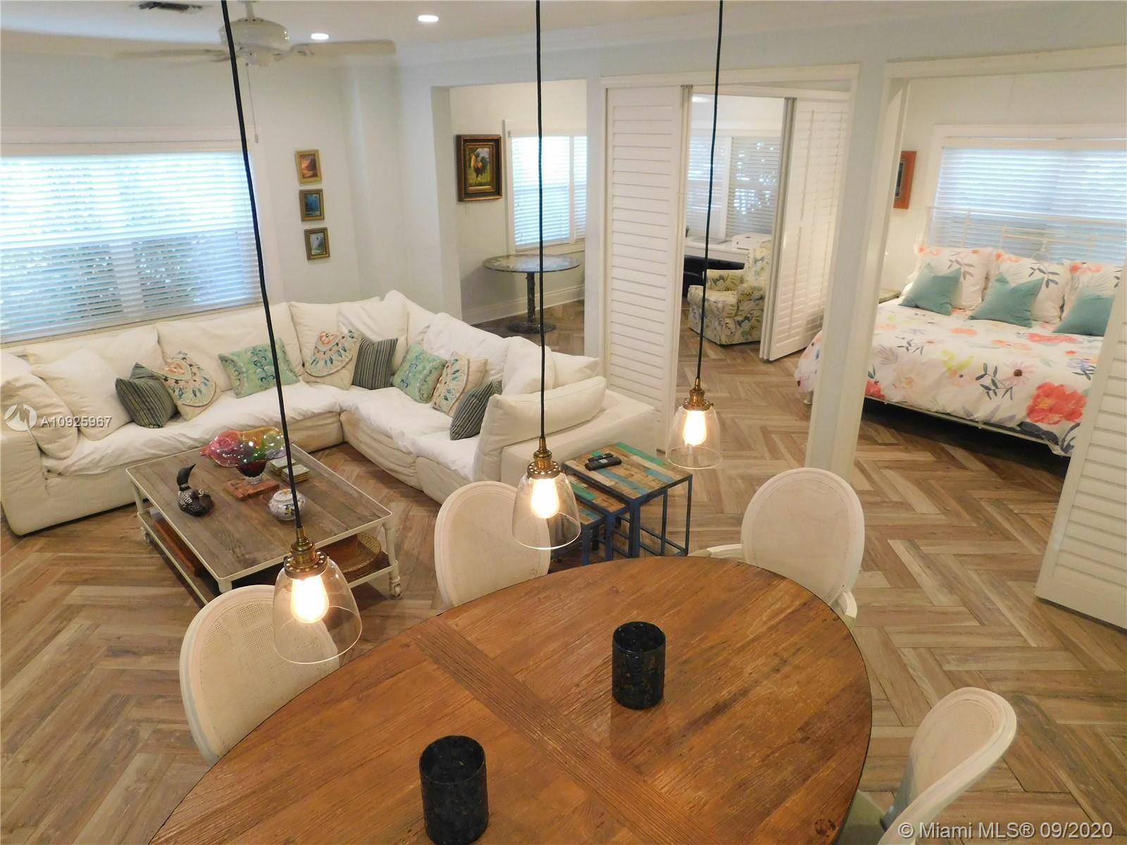 SOPHISTICATED AND FULLY REMODELED BEACH HOME WITH A COTTAGE LOCATED JUST A FEW STEPS FROM THE BEACH
