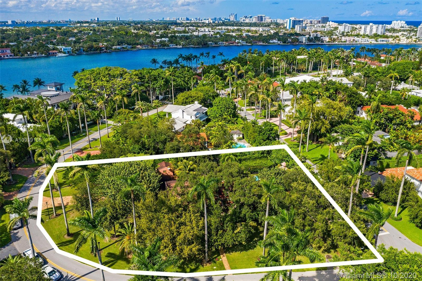 Once-in-a-lifetime opportunity to own this oversized corner lot on one of Miami's most coveted, priv