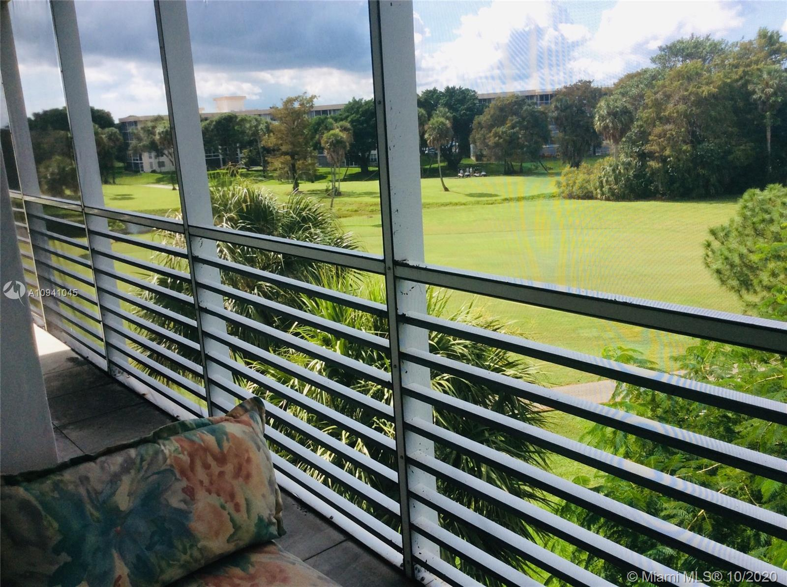 SPECTACULAR GOLF VIEW FROM THIS UPDATED 3/2 CORNER UNIT.  OPEN KITCHEN WITH STAINLESS STEEL APPLIANC