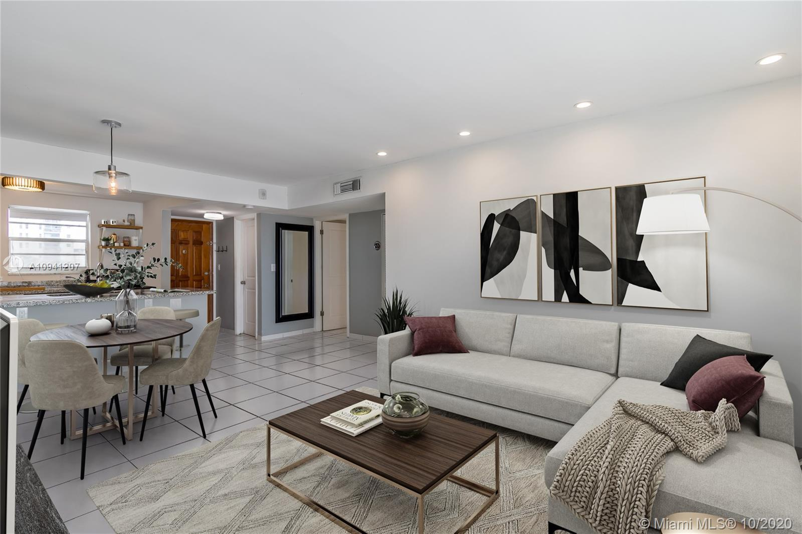 Sophisticated modern style in this beautifully updated 2 bedroom 2 bath residence with open kitchen,