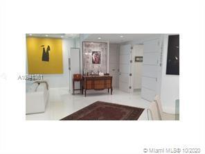 A MUST SEE SPECTACULAR AND ELEGANTLY PROFESSIONAL DECORATED APARTMENT. FENDI FURNITURE IN LIVING ROO