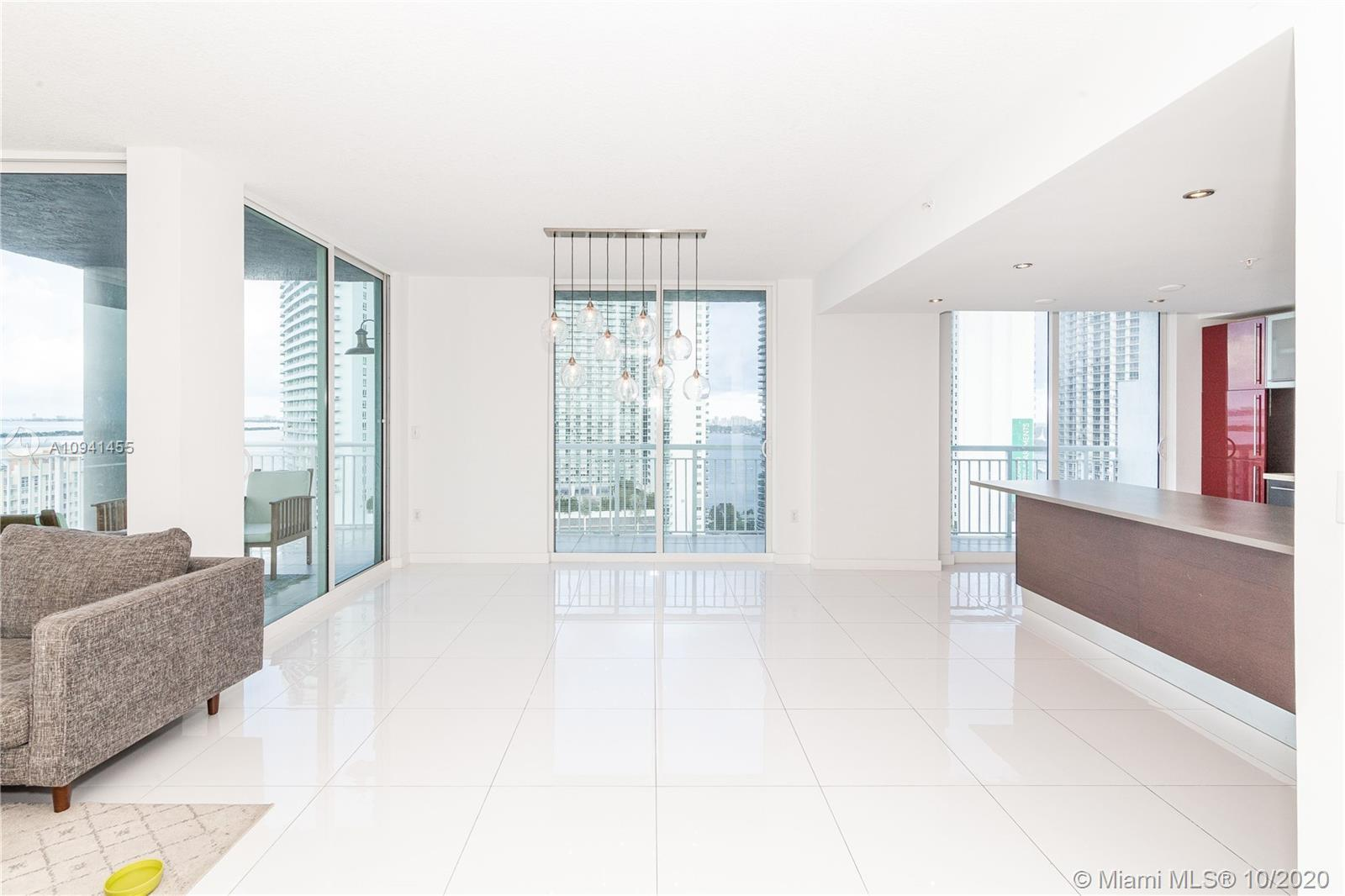 STUNNING Bay and city views.2-Story Penthouse,3 huge terraces, white ceramic tile, updated kitchen w