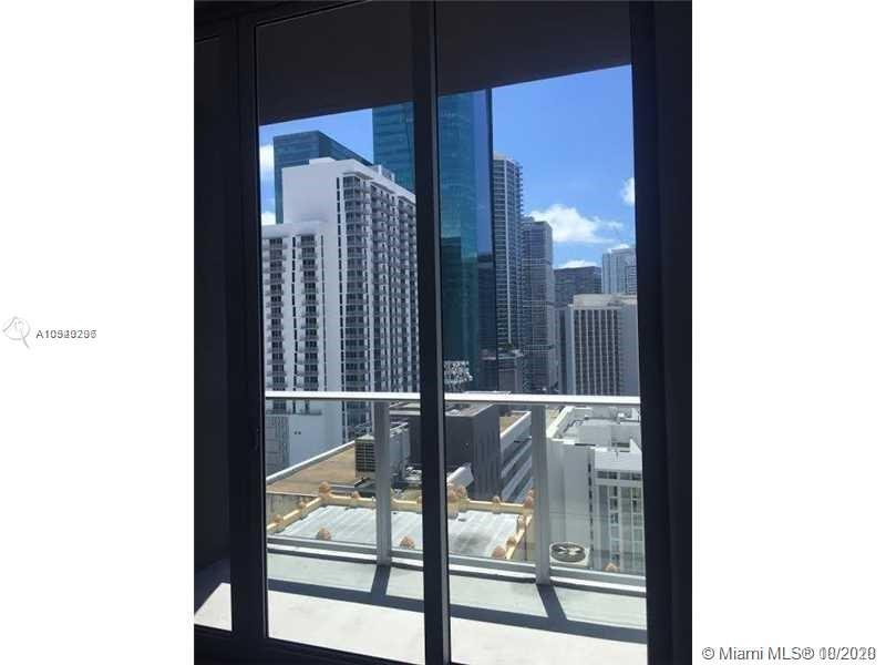 Modern building in the heart of Miami Down Town. One-bedroom open floor plan apartment, concrete flo