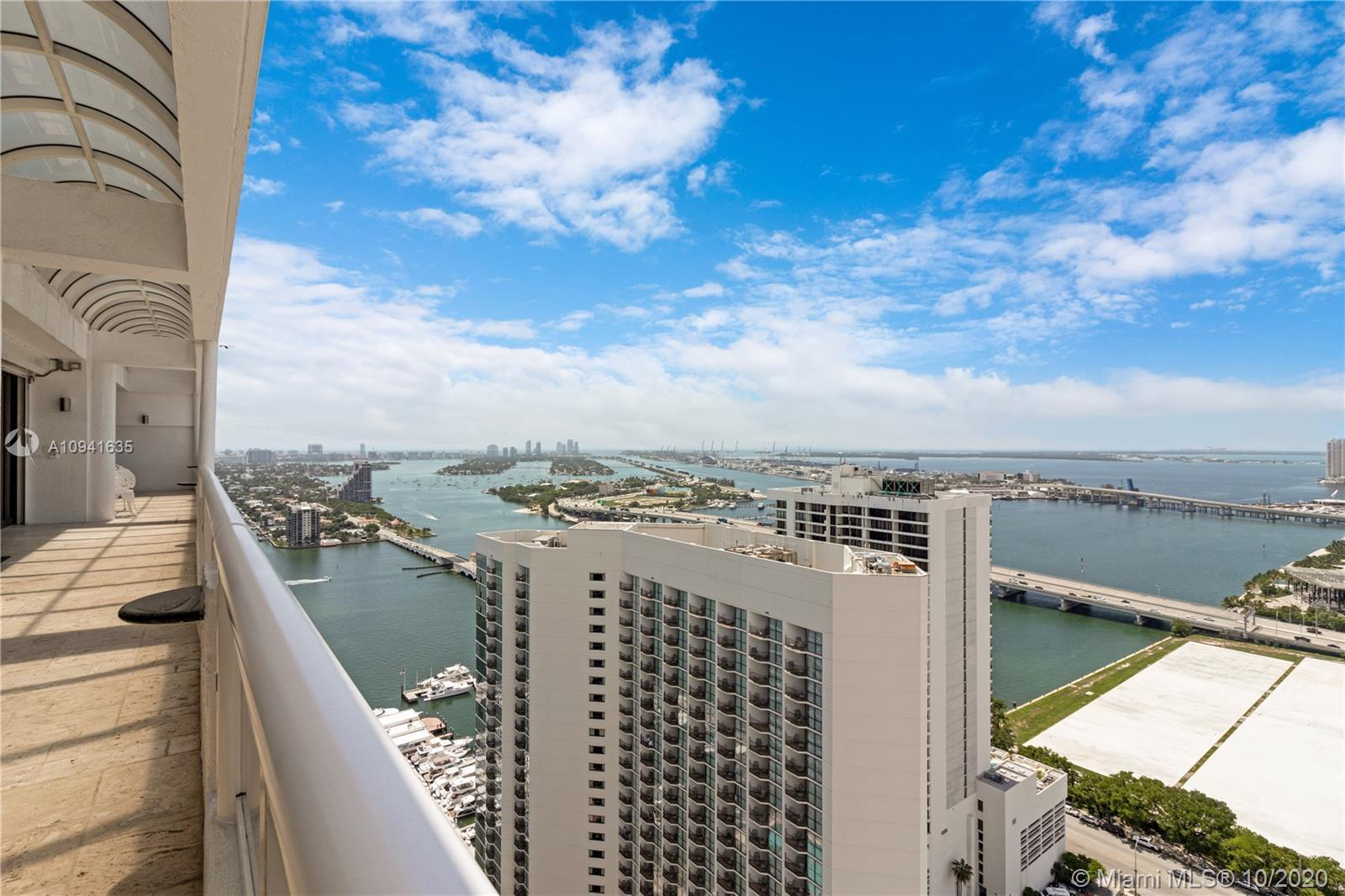 Top floor penthouse with spectacular panoramic views of the bay and the Miami skyline. EVERYTHING in