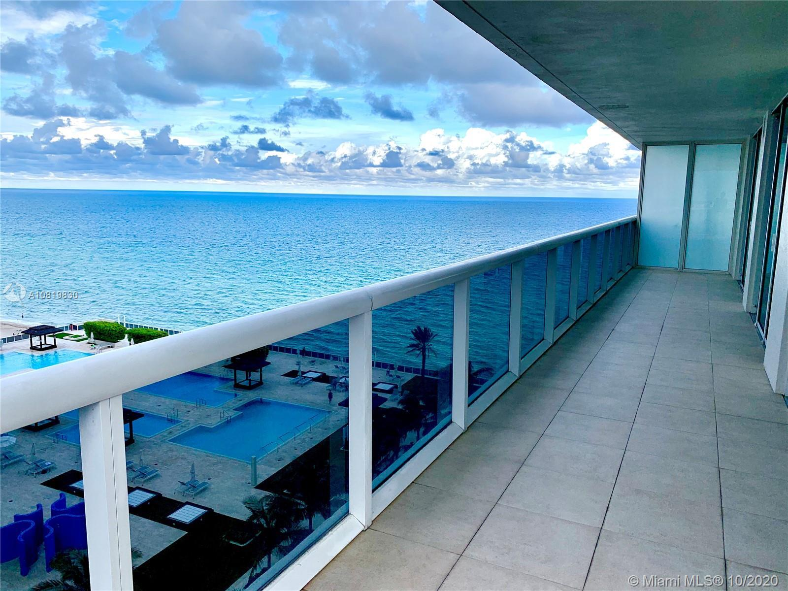 Spectacular unit features 1,458 sq ft. 2 bedroom 2 baths, wraparound balcony with beautiful ocean an