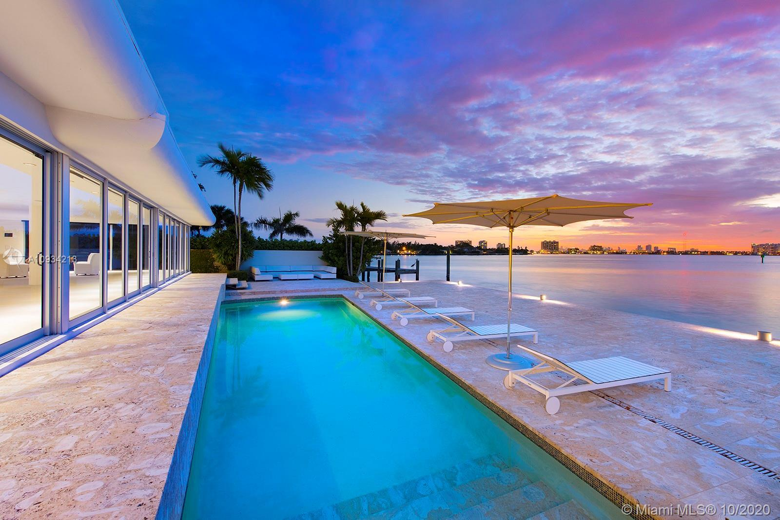 This home's lot has the best views on the island! Located at the tip of guard gated Biscayne Point i