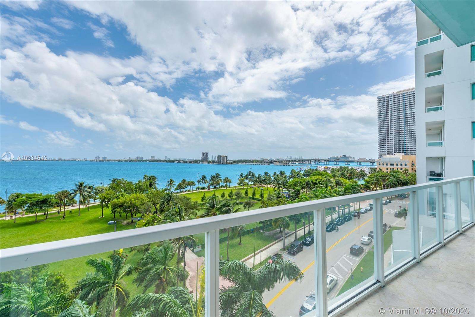 Enjoy unobstructed sunrises, shimmering bay views & watch the cruise ships go by from this coveted L