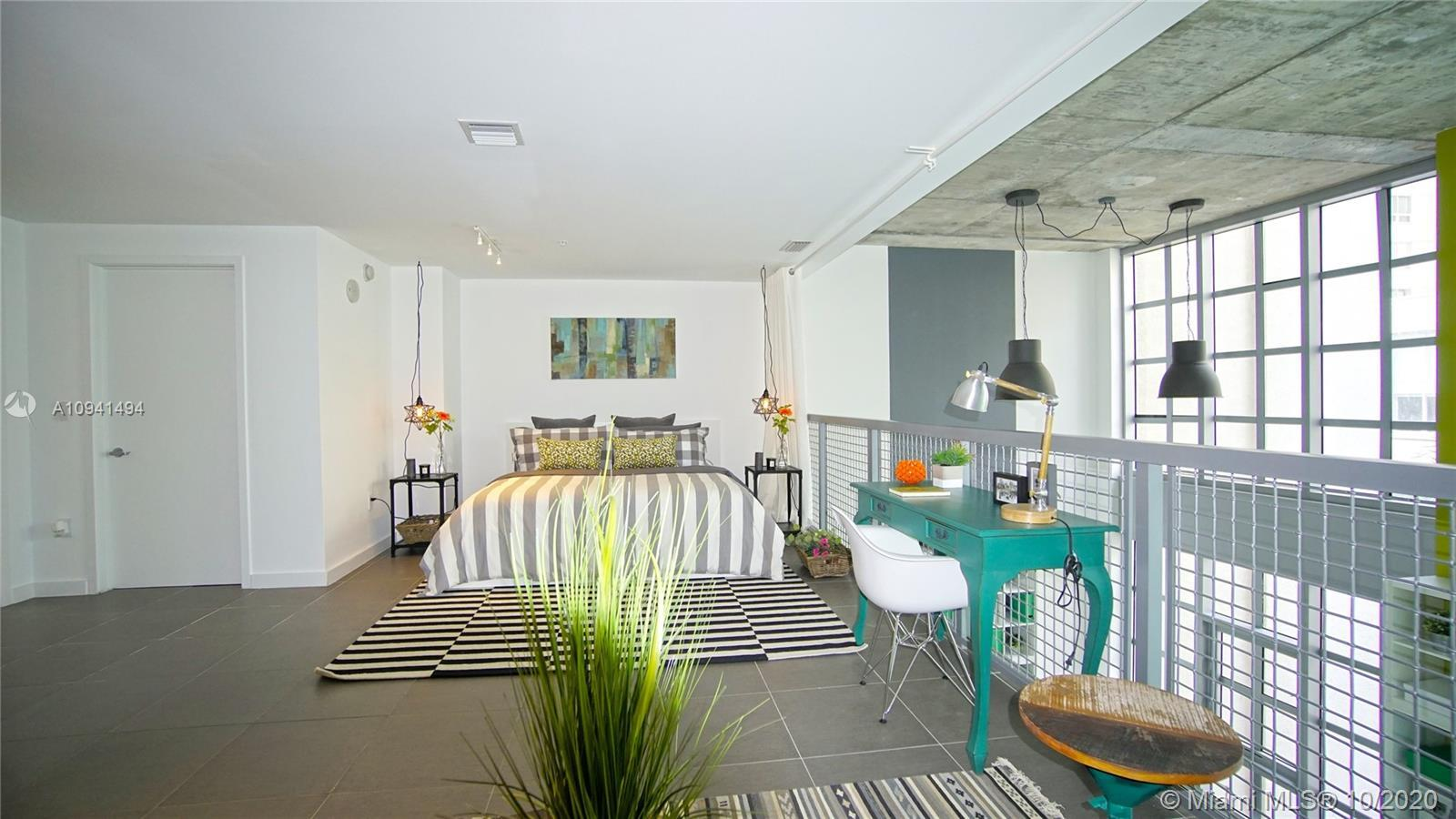 Unique 2- Story - Live/work Loft style- This property can be converted into three (3) bedrooms with