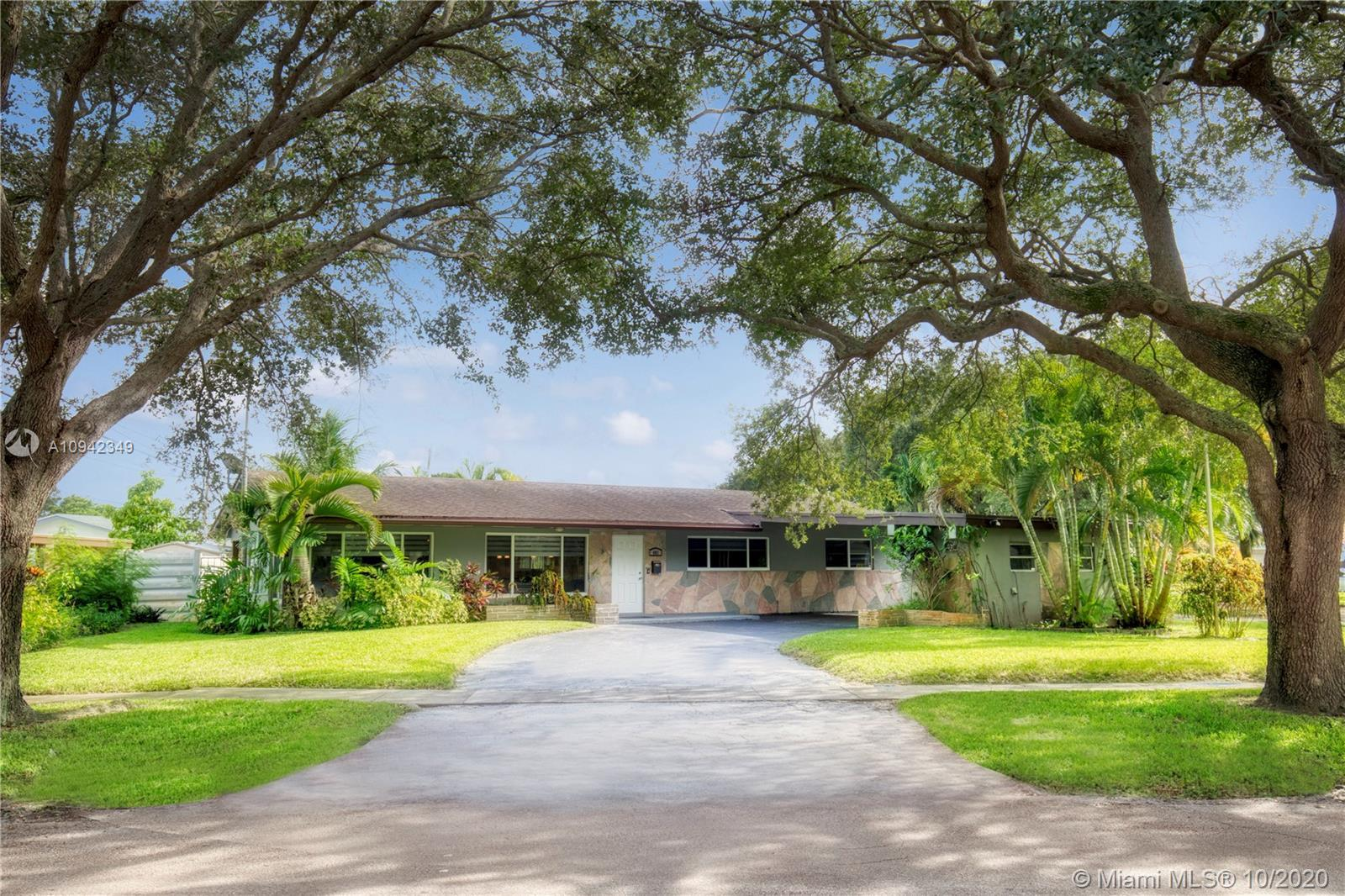 HIGHLY UPGRADED 3 BED/2BATH SMART HOME ON AN OVERSIZED CORNER LOT BOASTING A LARGE CIRCULAR DRIVEWAY