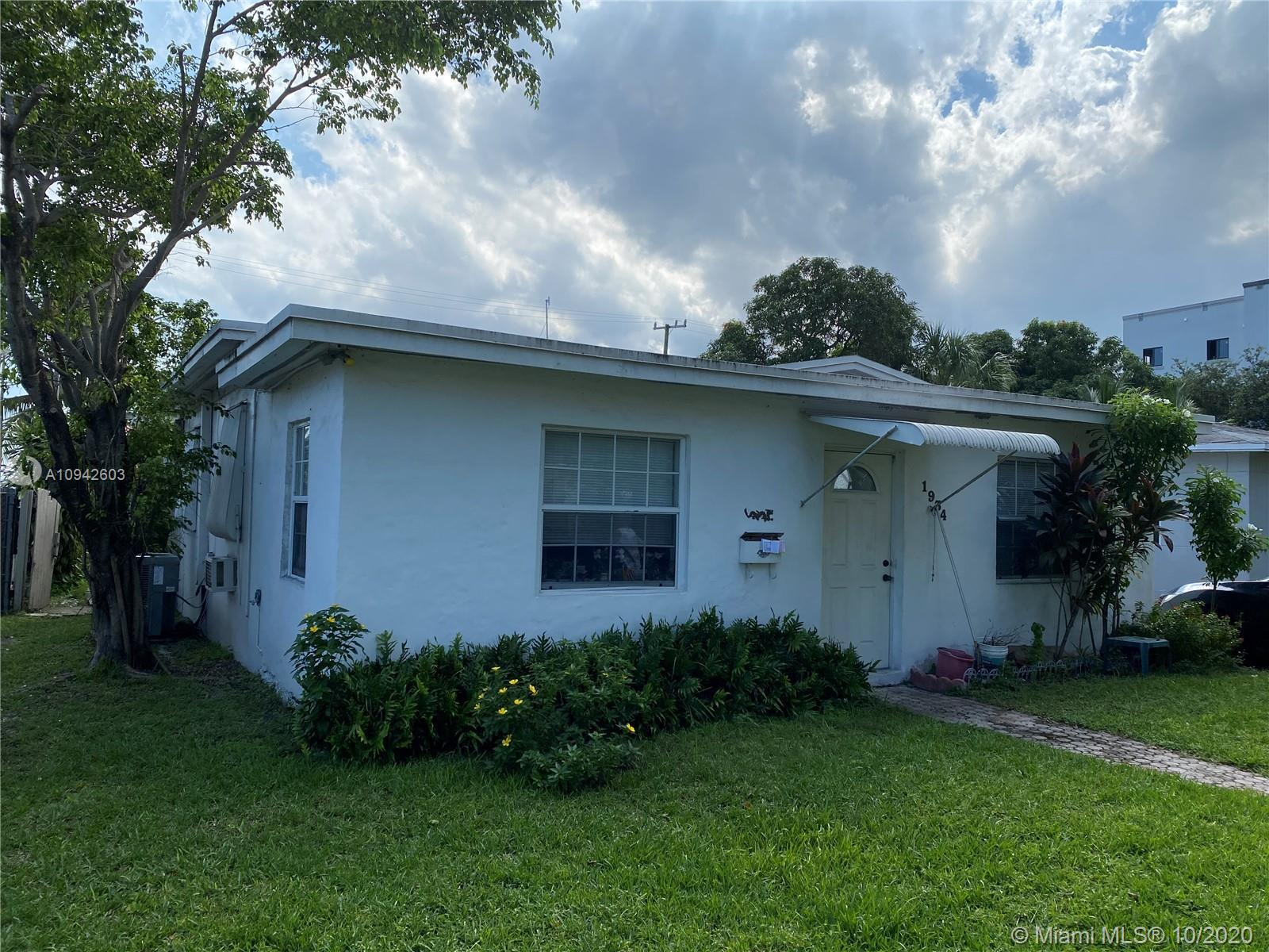 Perfectly Located! Just off of US1 this 2 bed/2 bath home has a rear structure that is currently bei