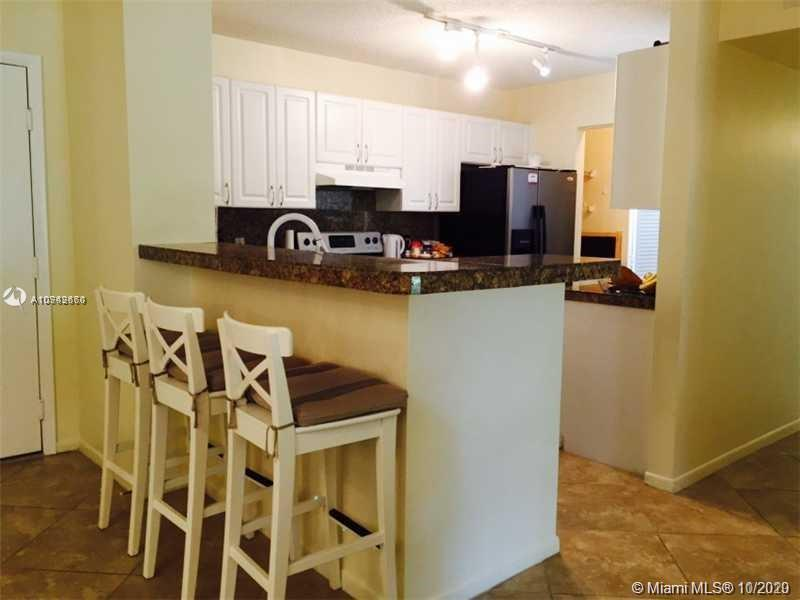 2/2 at the Yacht Club.  Open Kitchen, Washer/Dryer inside condo. Bright unit with tile floors in liv