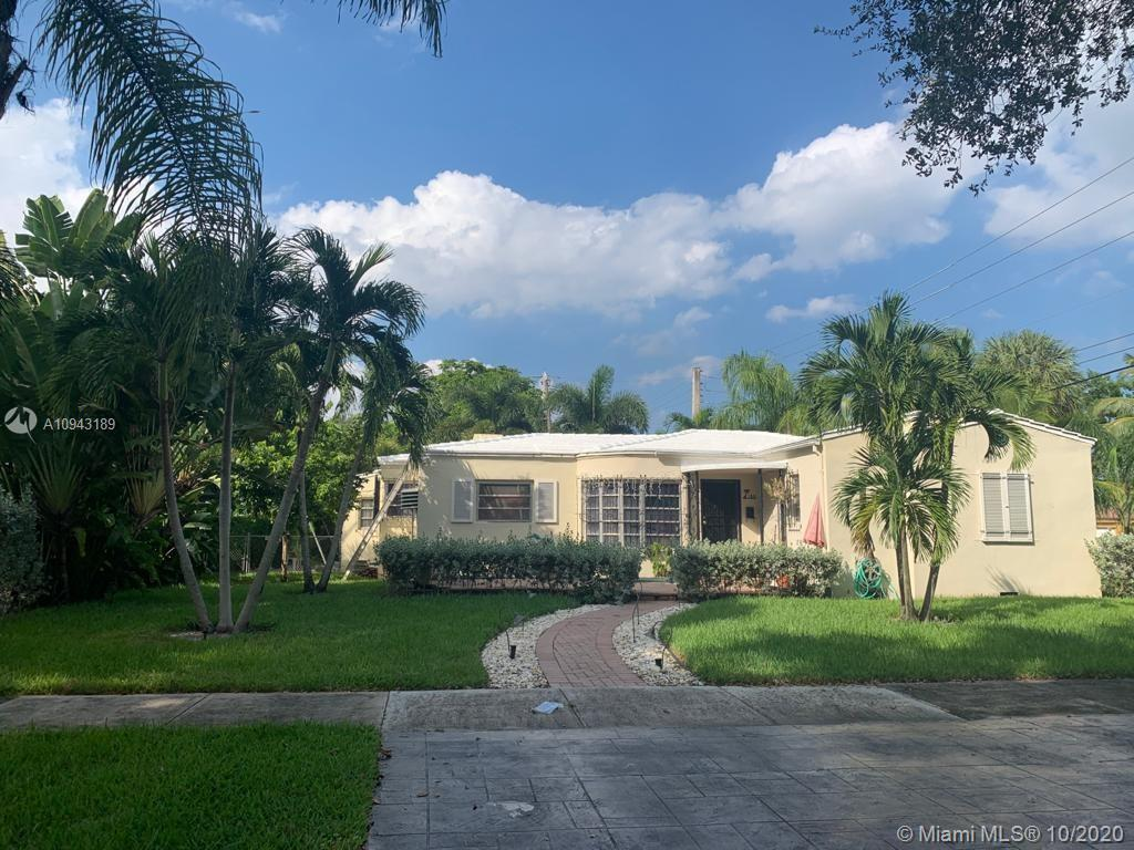 UNIQUE AND CHARMING 4 BED/4 BATH  PLUS A DEN HOME ON A LARGE CORNER LOT IN DESIRABLE LOCATION OF MIA