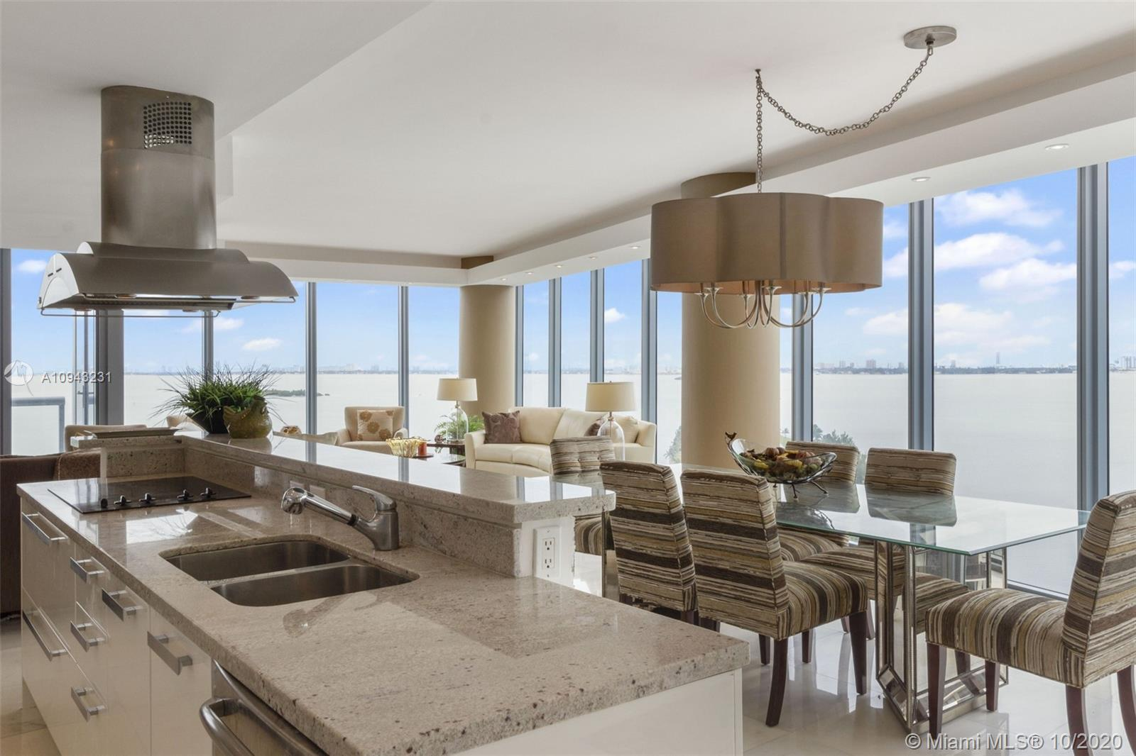 Best line in the building with extraordinary views of the Bay & Miami Beach. Beautiful Italian kitch