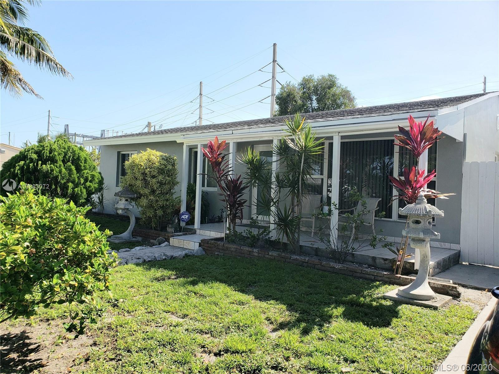 BEAUTIFUL CORNER 3 BEDROOM, 2 BATH PLUS DEN HOME IN POPULAR AREA OF HOLLYWOOD. YOUR NEW HOME HAS BEE