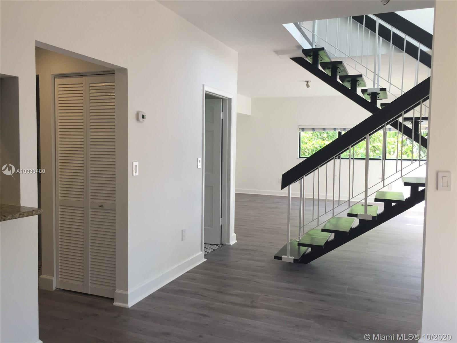 Beautiful, completely remodeled loft style 2/2.5 unit at Brickell Forest. Washer/Dryer in the unit.