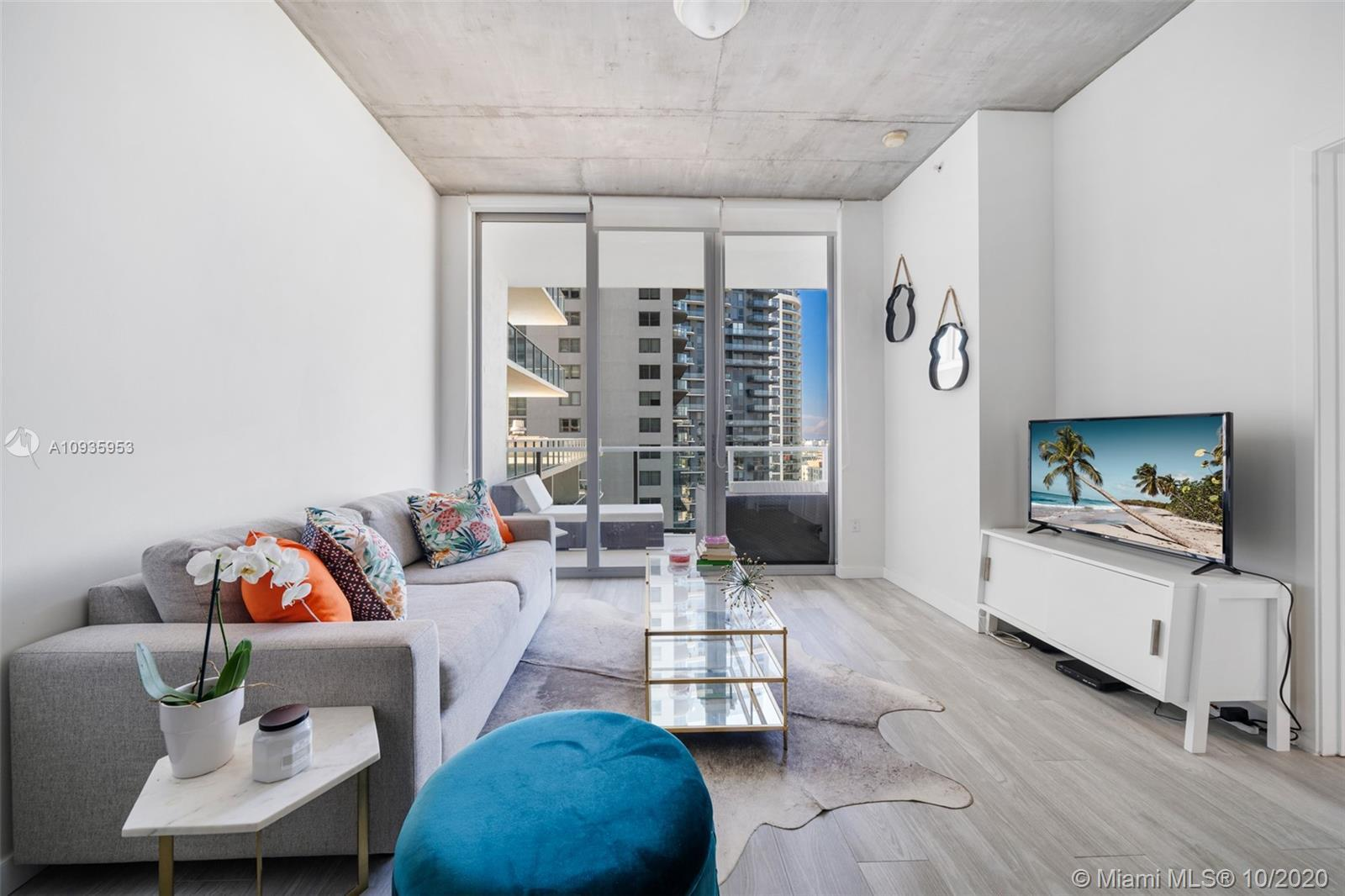 Fully renovated unit with high end Italian porcelain floors and bathroom tiles, quartz counter tops,