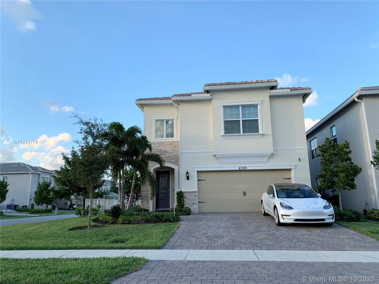 CORNER LOT WITH FENCE and hedges surrounding. Beautiful modern home in gated community Parkview at H