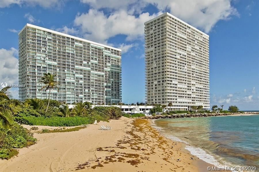 Direct East Oceanfront Large Corner Unit with oversized wrap-around balcony in glass, this amazing 2