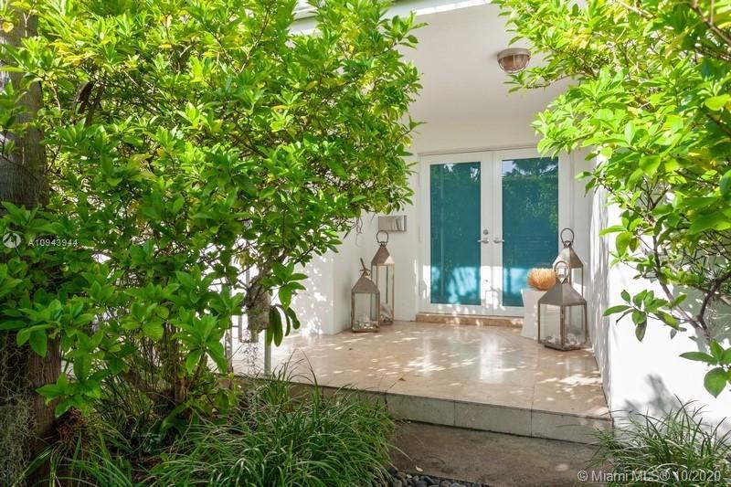 Miami meets Bali... Corner lot, surrounded by lush gardens. Live on this tropical oasis located at p