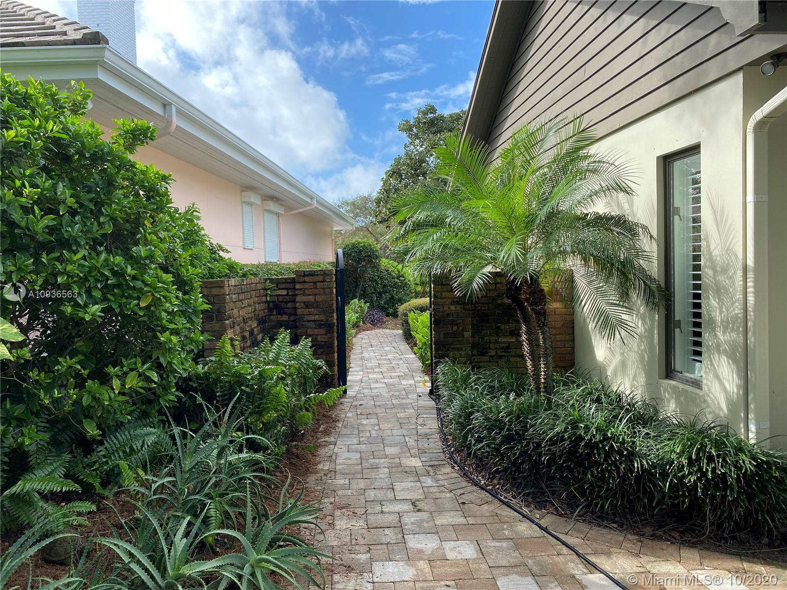 Completely newly remodeled courtyard home on the 14th hole of the Village Course. Private end unit,