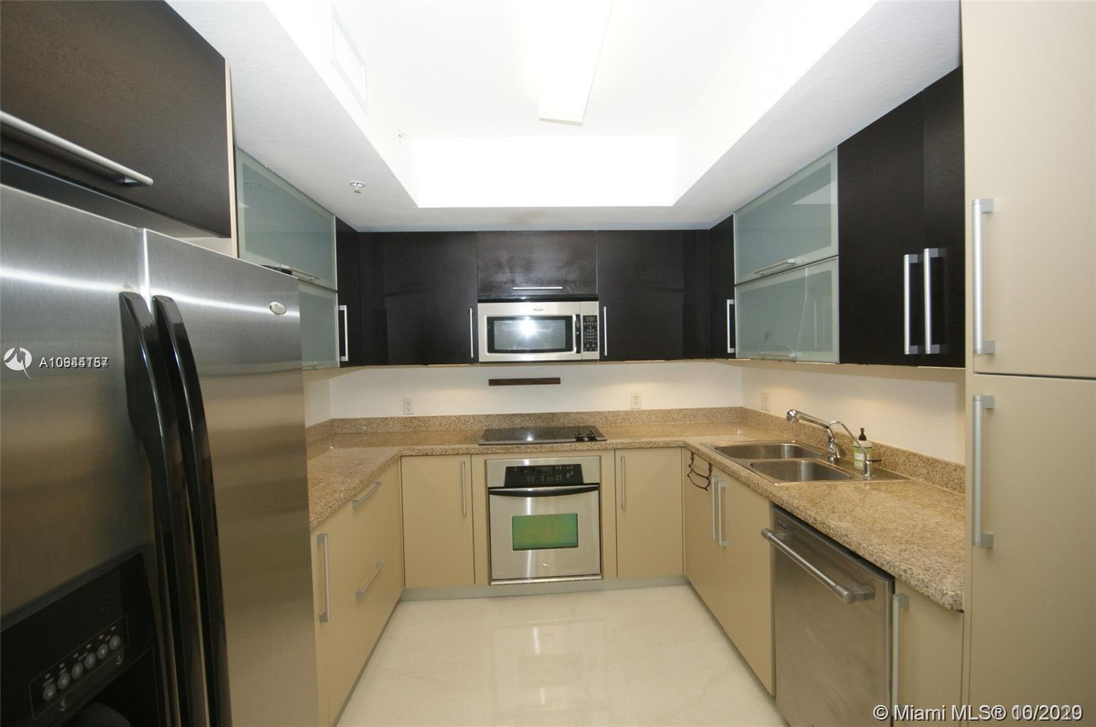 Amazing price on a 2/2 Biscayne Bay view updated condo with Balcony. Porcelain Floors, Italian Kitch