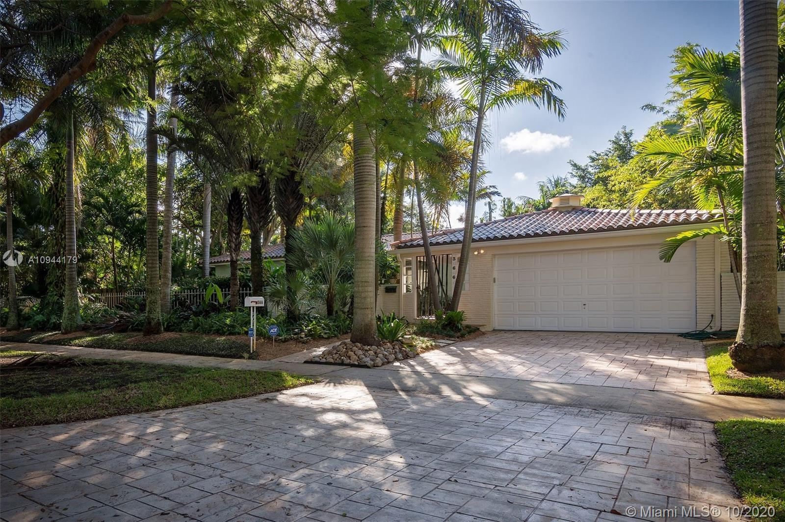 Tropical Oasis on a huge double lot. Located on one of the best streets in Miami Shores! 4 bedrooms