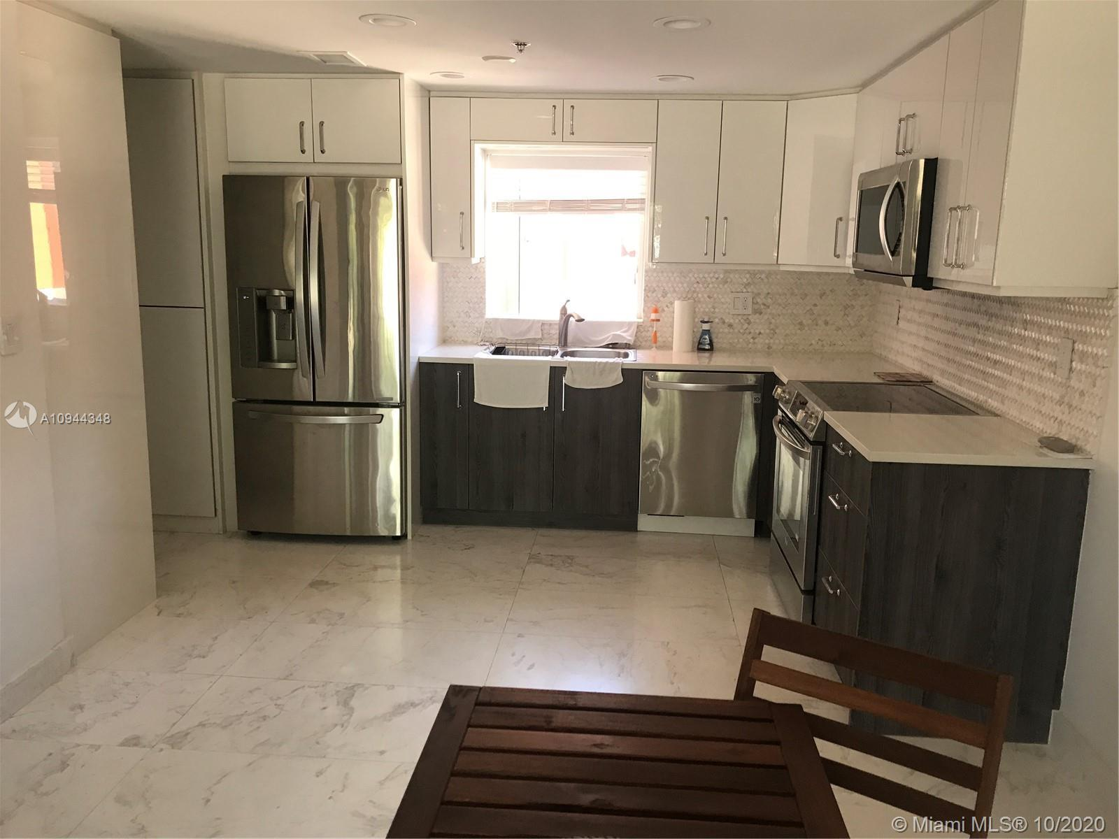This unit has been completely remodeled. Marble throughout this 2/2 townhouse with glass railings. T