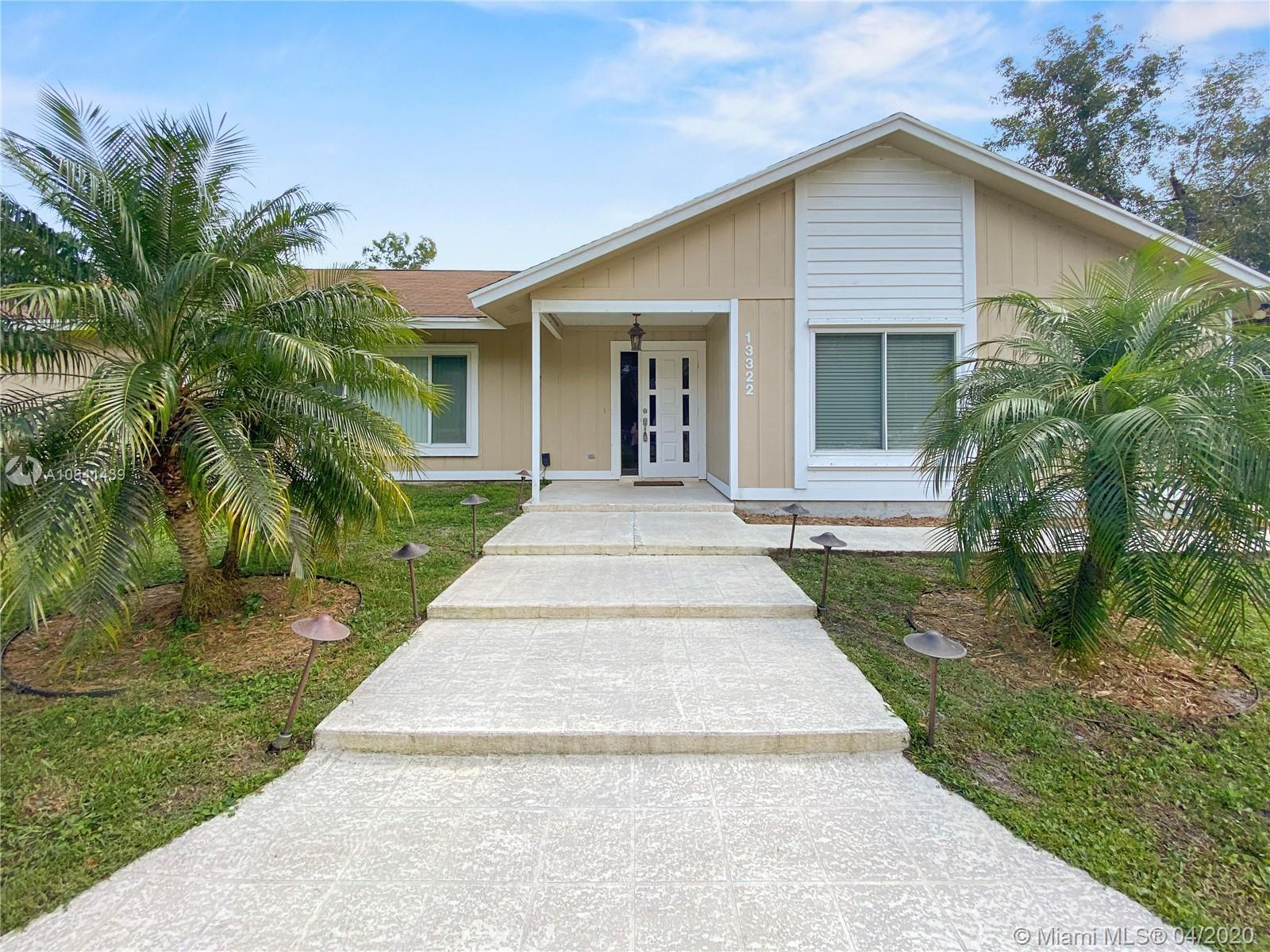 Jupiter Farms 3 Bedroom 2 Bath, Split Plan Pool Home. This property has a 4 Stall Barn with an Air C