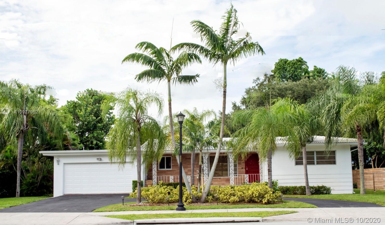 Fantastic 3/3 contemporary home in Miami Shores. The home has an open concept featuring a spacious e