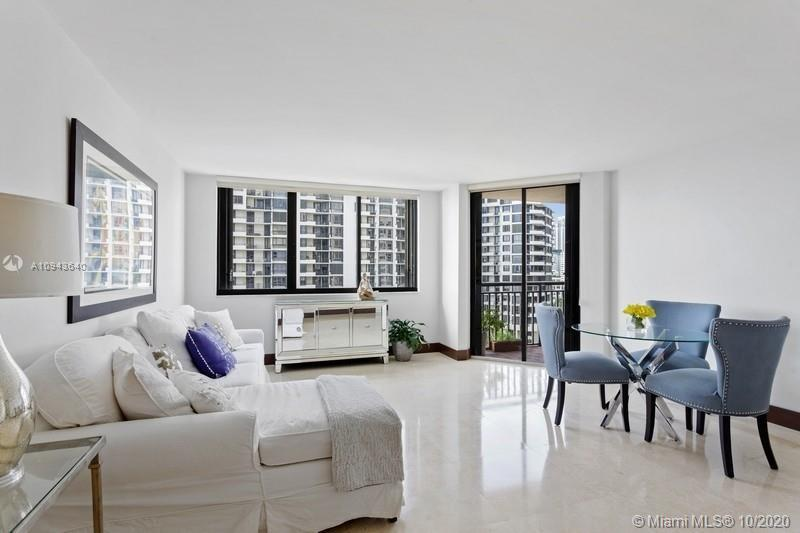Remodeled 2 bed, 2 bath unit with ocean view in exclusive Brickell Key Island. New kitchen with sta