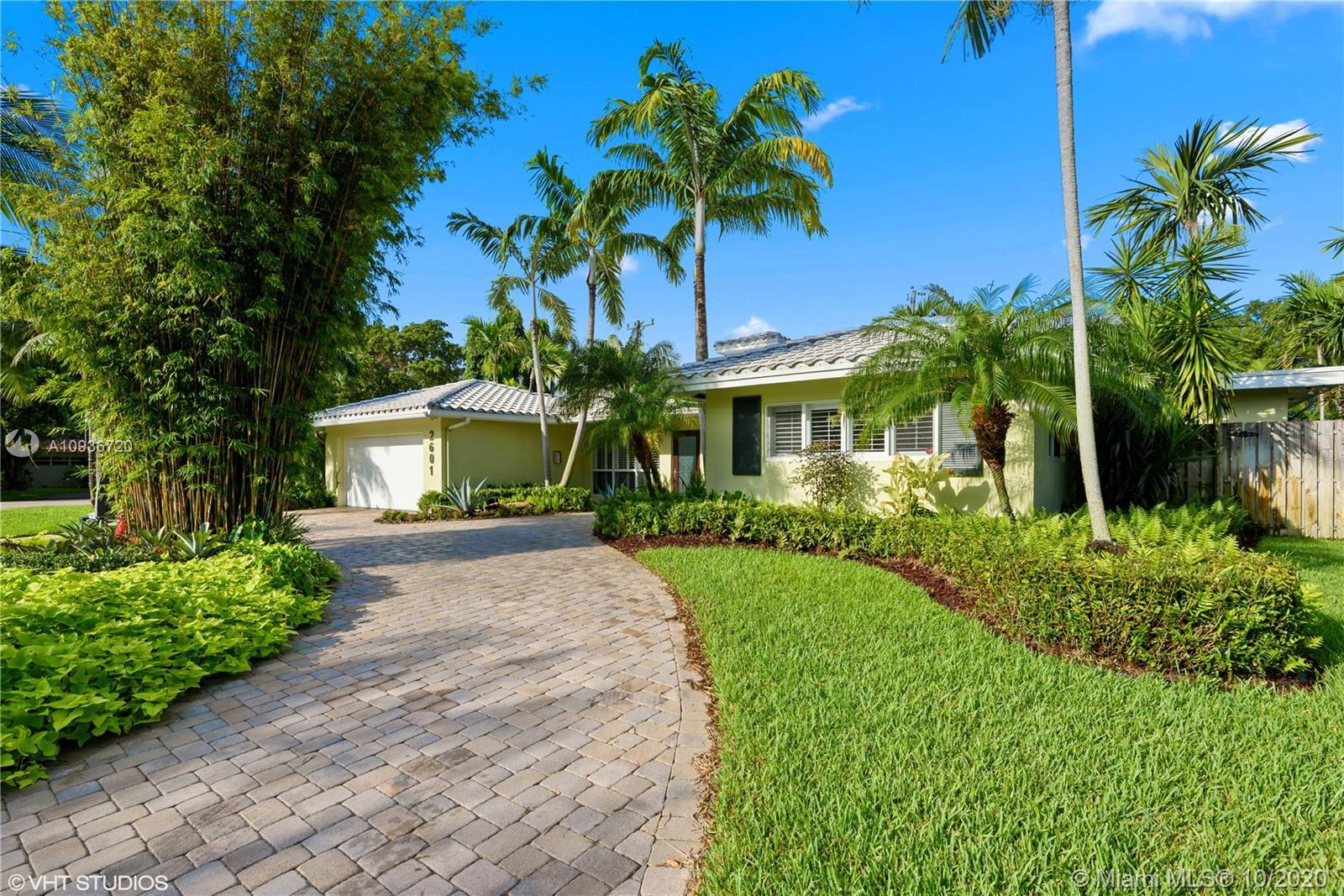 This spectacular 3,000+ square foot pool home is situated on an over-sized, lushly landscaped corner