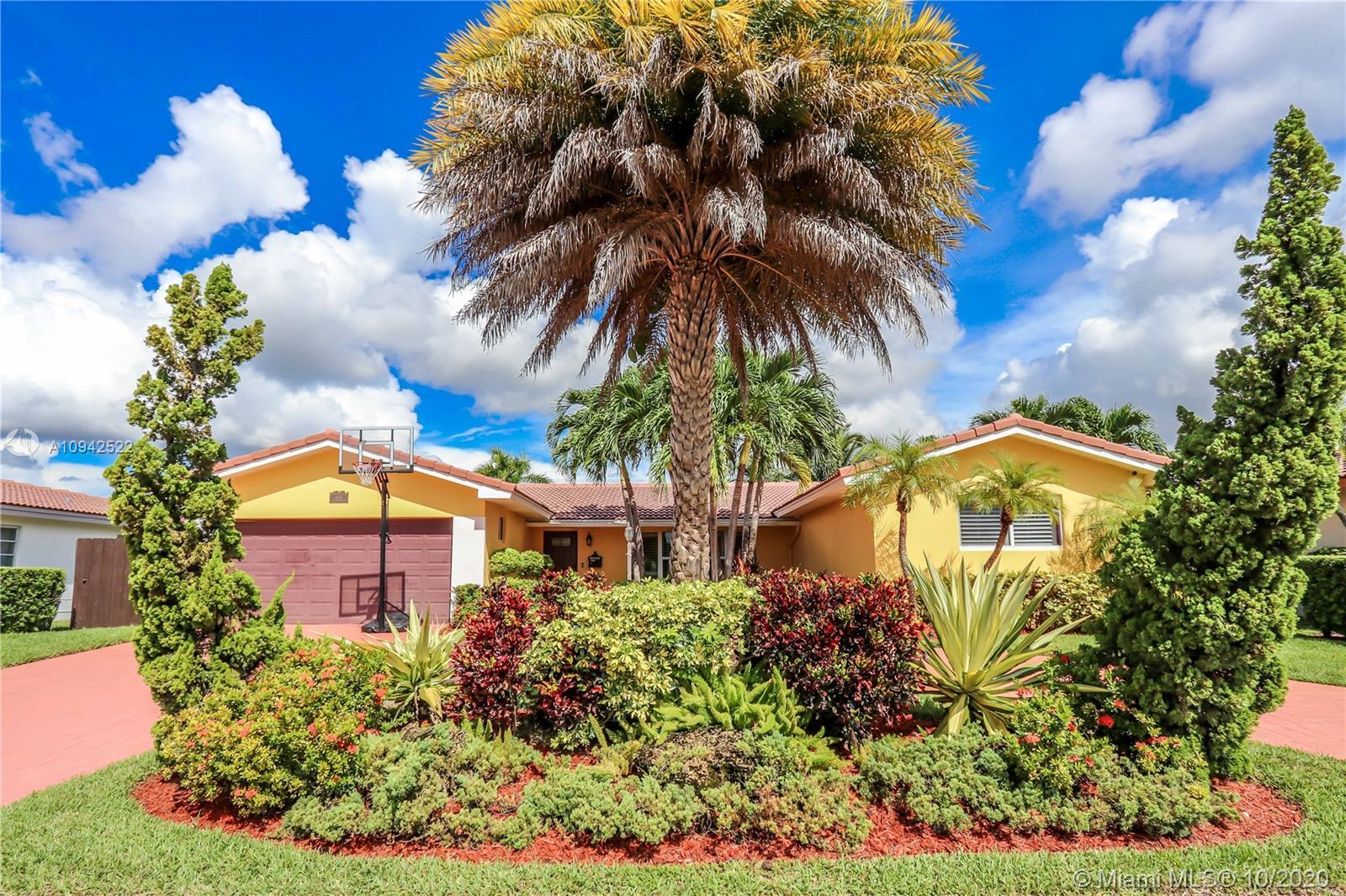 Spectacular 4/3 home features beautiful pool with waterfall and hot tub. Pool has salt water system