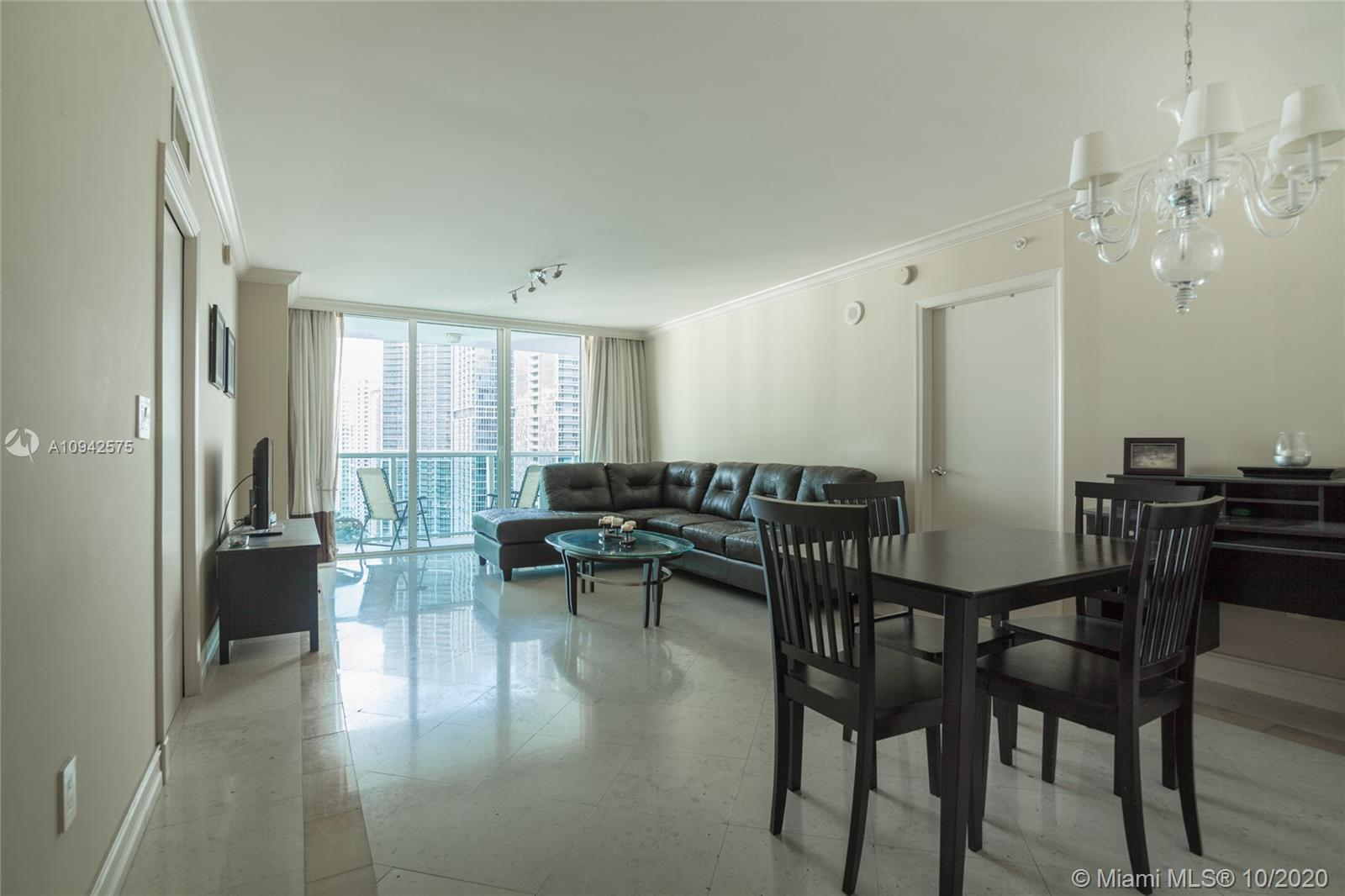 IMPECCABLE WATER VIEW UNIT IN THE HEART OF BRICKELL. THE MOST BEAUTIFUL APARTMENT IN THE BUILDING. F