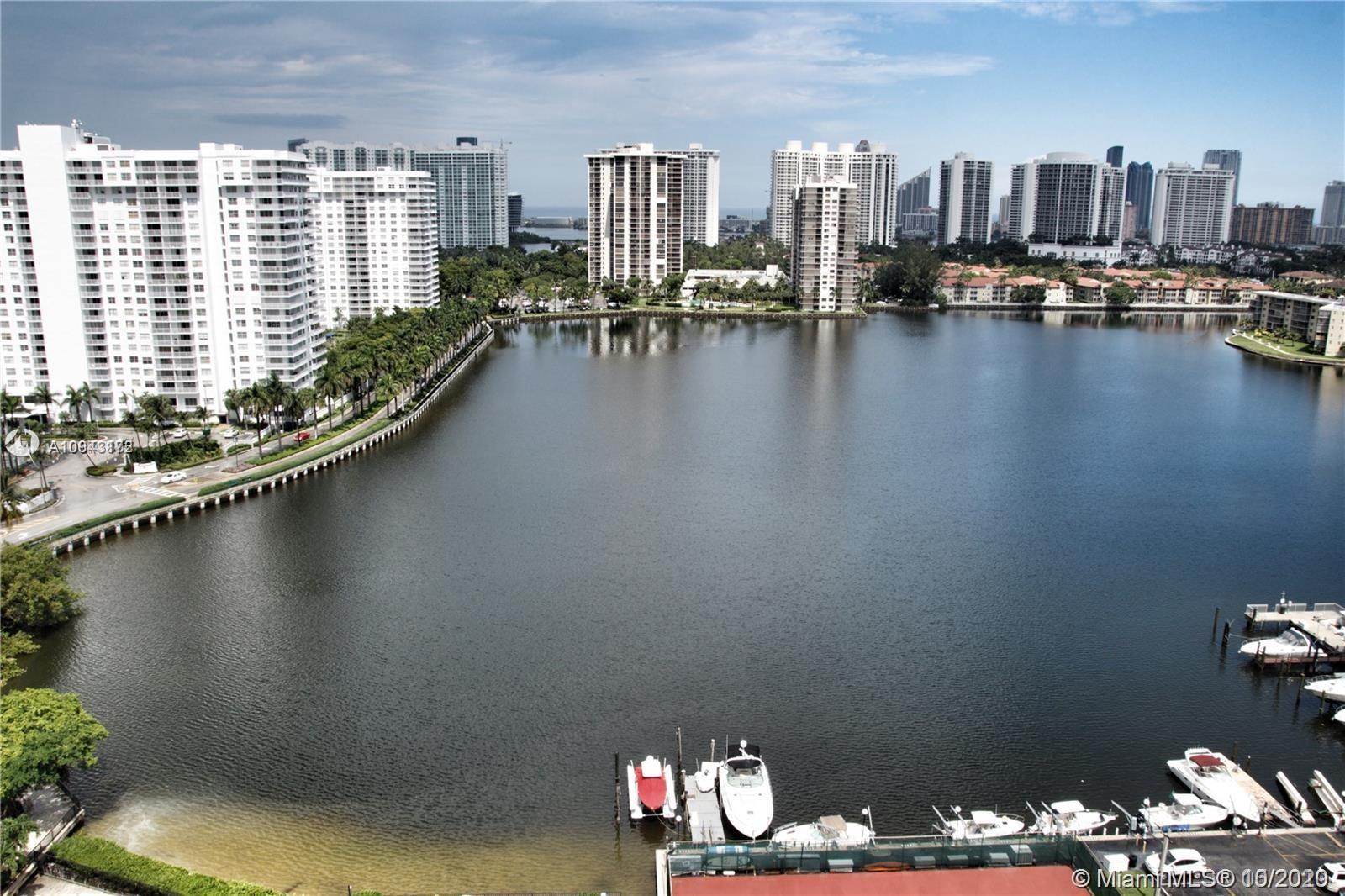 Priced to sell! Breathtaking views of the Maule Lake, Ocean, Intracoastal. Remodeled unit. Tiles and