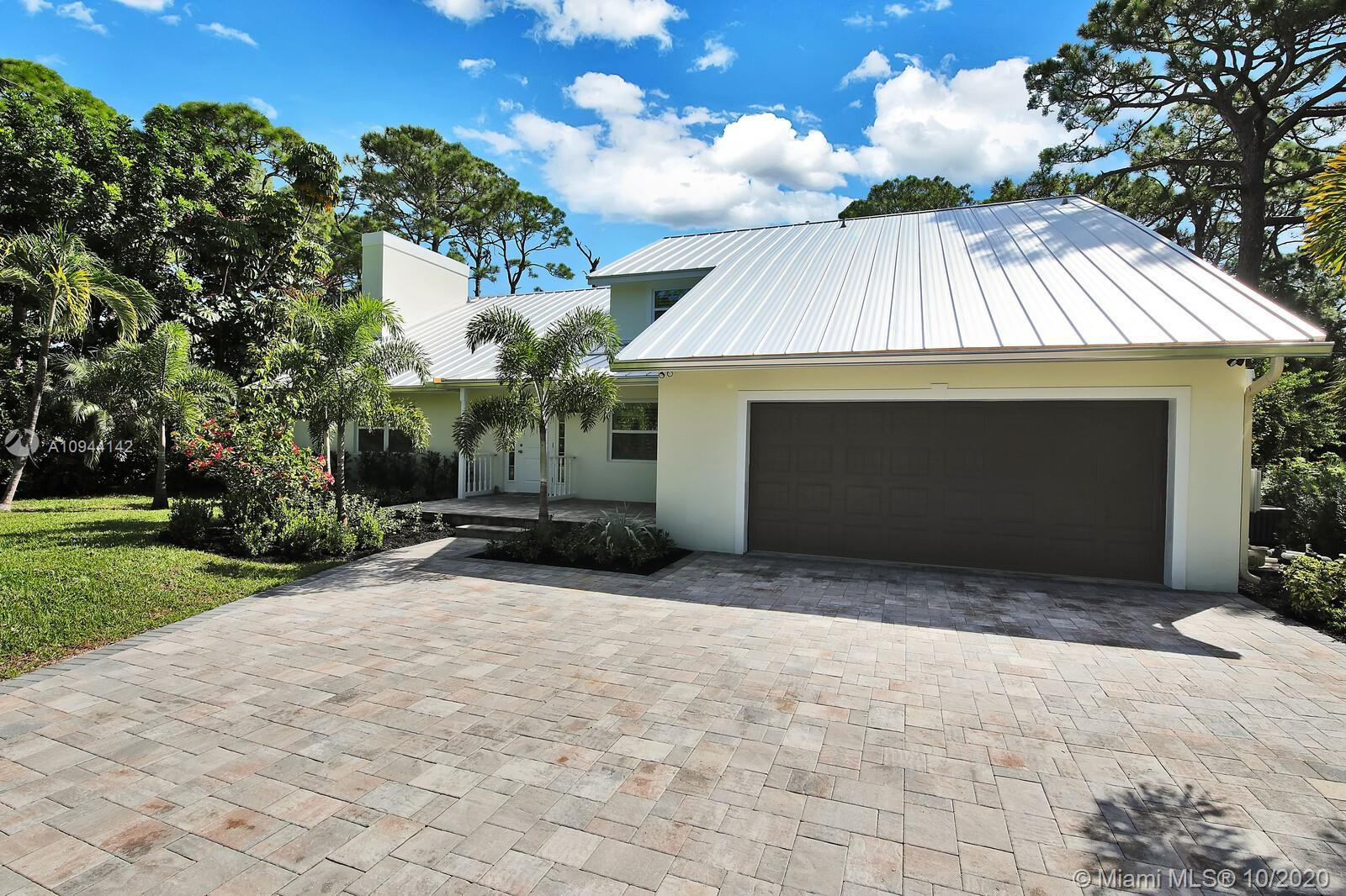 This large STUNNING ONE-OF-A-KIND ultra-private, completely remodeled, custom pool home is located i