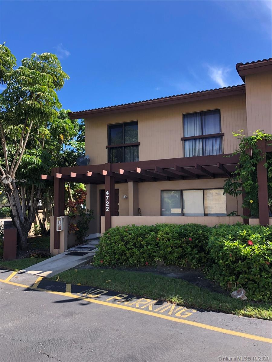 Spacious corner townhouse with community pool. Porcelain flooring throughout the first floor. New, g