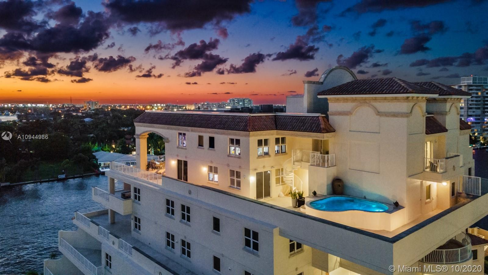 Stunning views abound from this spectacular one of a kind duplex penthouse in the sky. Featuring ove