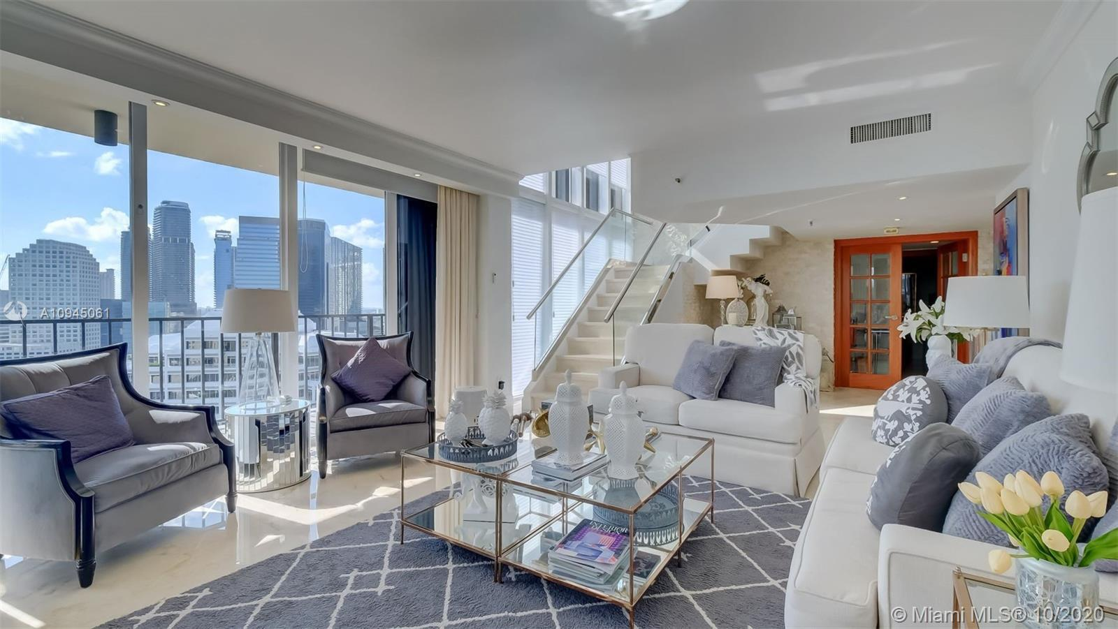 Contemporary, spacious, and recently renovated oceanfront 2-story residence in the prestigious Brick