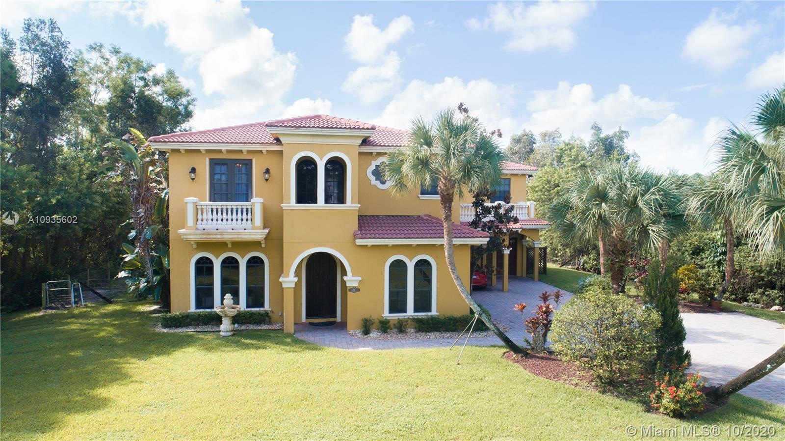 Nestled on 1.33 acres in the pastoral beauty of Jupiter Farms, this secluded Mediterranean influence