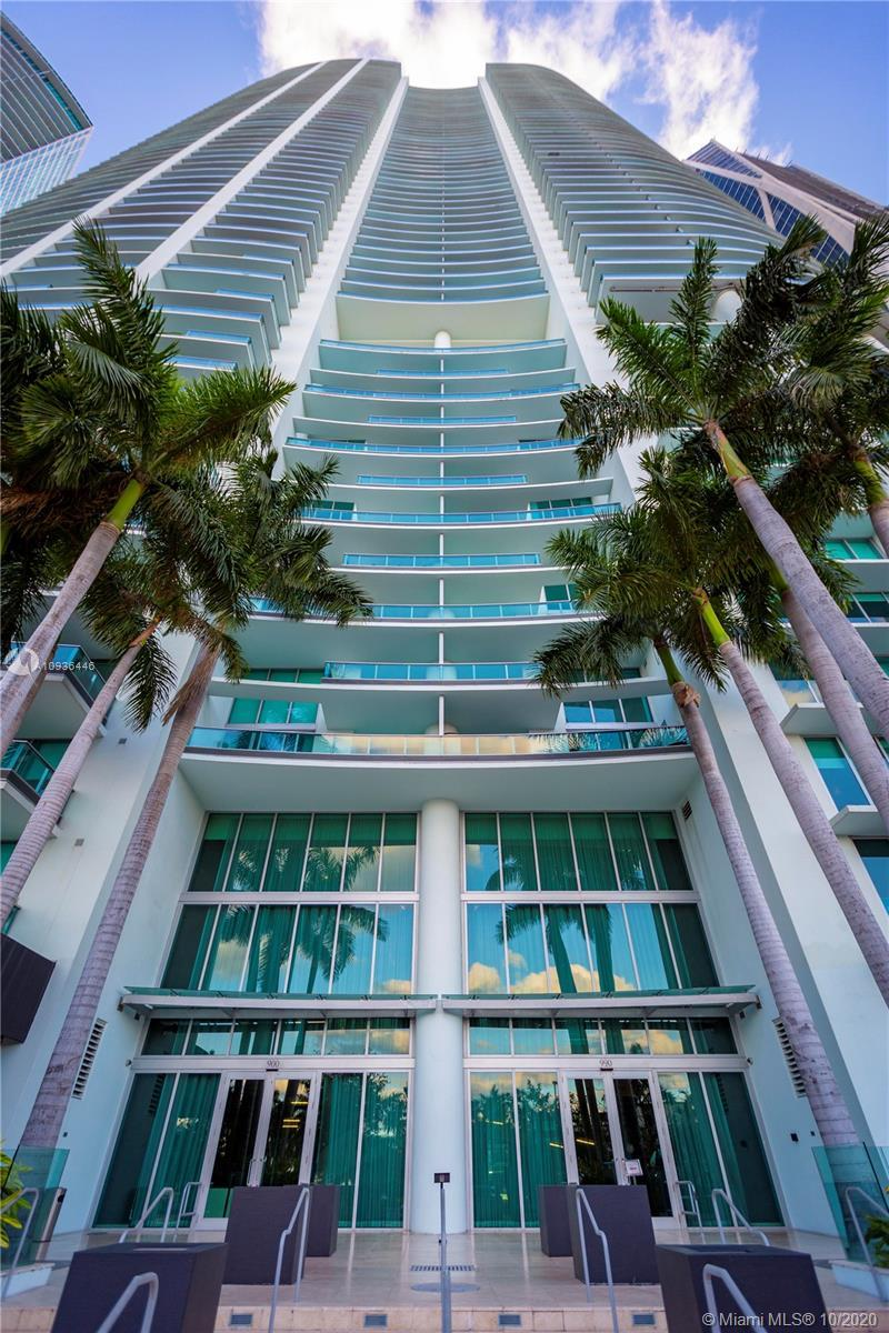 Relax and enjoy the view. Perched atop Biscayne bay sits this beautiful 2-bedroom, 3-bath Condo with