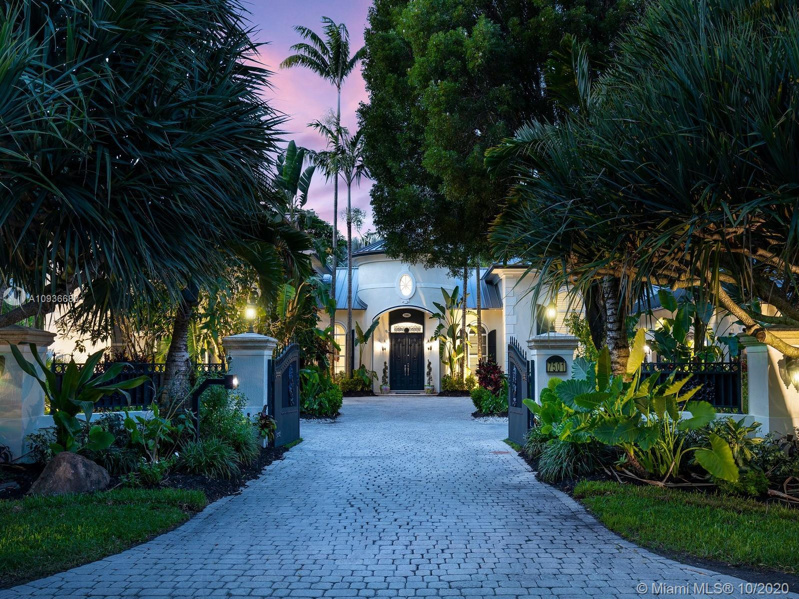 Luxurious Spanish Style Estate located in sought after N Pinecrest. Enveloped by pristine landscapin