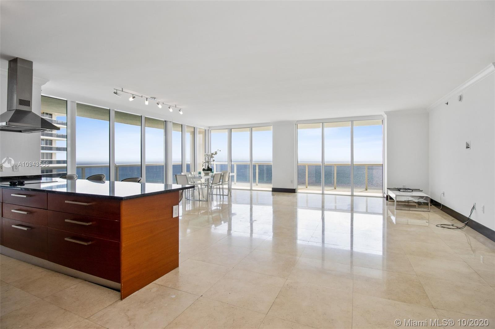 Beautiful corner unit with direct ocean view, wrap around balcony, 3 bed 3.5 bath, model B, marble f