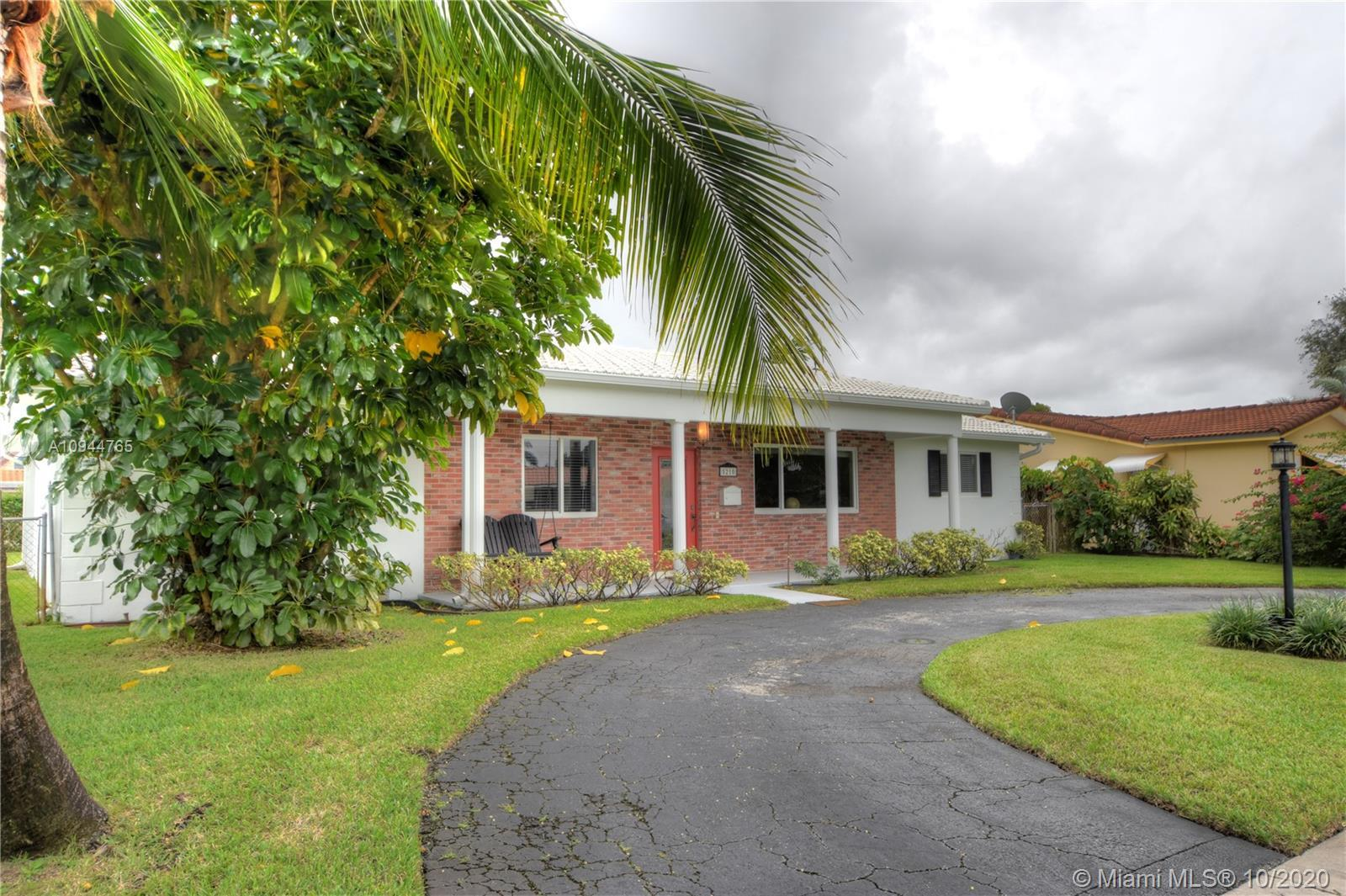 Meticulously well cared for home, open floor plan with wood flooring throughout.  Impact windows, do