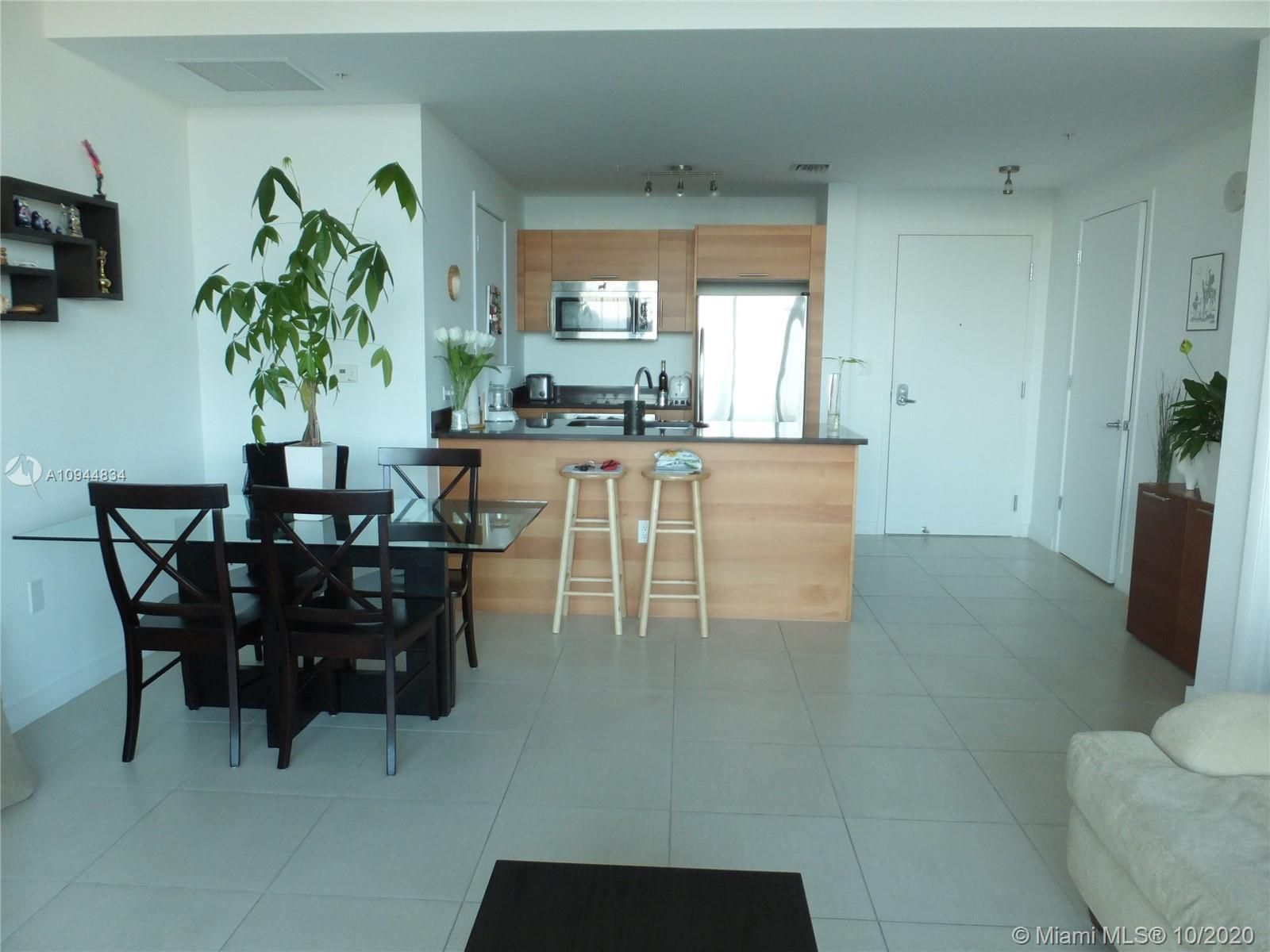 Spacious 1 bed / 1.5 bath unit at Four Midtown. Floor to ceiling windows, guest bathroom, laundry ro