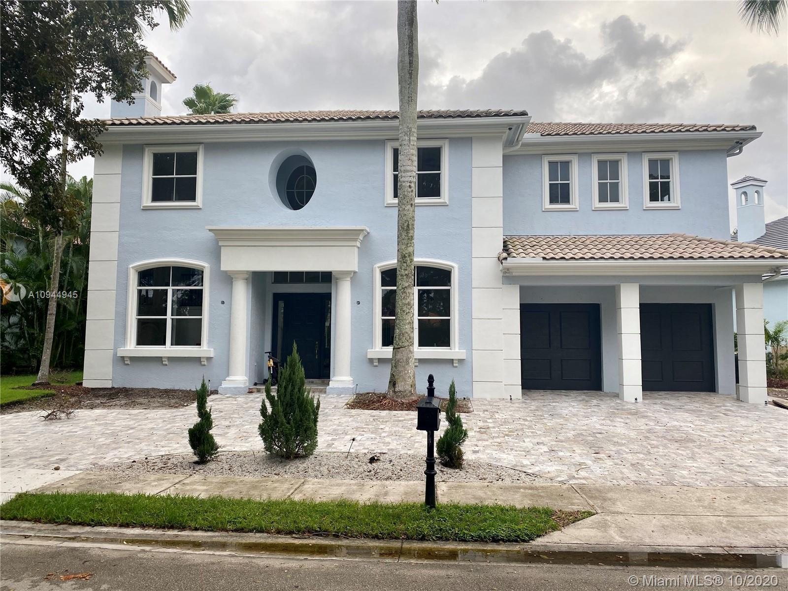 Completely renovated 2 STORY SINGLE FAMILY HOME in East Boca Raton in a Gated Community with full ti